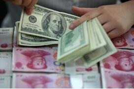 人民币对美元中间价调升1个基点